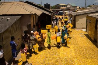 Imagining them as objects of art, Afrogallonism turns yellow gallon containers or jerrycans to plastic carpets to #SolveDifferent. Photo by Serge Attukei Clottey / Afrogallonism