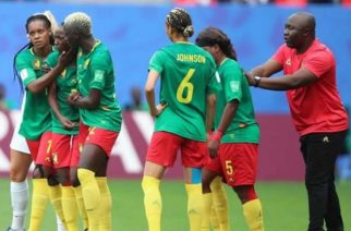Cameroon coach Alain Djeumfa (right) encourages his team to continue after Ajara Nchout's goal was ruled out for offside
