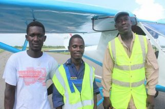Isaac and Jacob stand beside their GHOFI 1601 aircraft that awaits license to fly. - Adom Online
