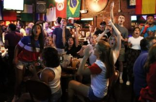 Gaites Layton, right with her hands up, celebrating the US win