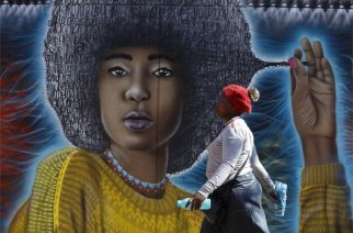 A woman walks past this mural in Johannesburg's fashionable Maboneng neighbourhood on Tuesday.