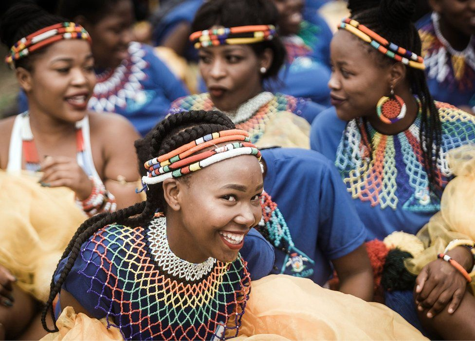 In South Africa, women dressed in traditional regalia sing and dance at a rally to commemorate King Shaka, the founder of the Zulu ethnic group...