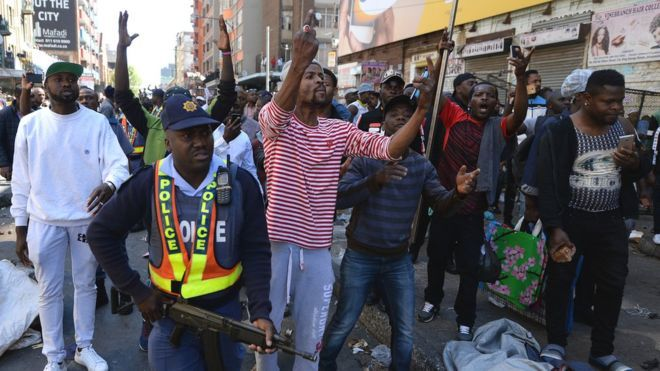 Police have struggled to contain the crowds of rioters who have looted shops and torched vehicles