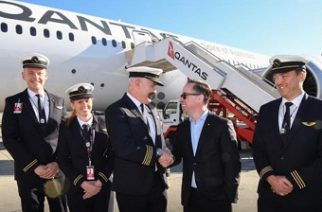 This handout photo, from Qantas, shows Qantas Group CEO Alan Joyce (C-R) shaking hands with Qantas pilot Captain Sean Golding (C-L) with the crew in front of a Qantas Boeing 787 Dreamliner plane after arriving at the Sydney international airport after completing a non-stop test flight from New York to Sydney, on October 20, 2019. (Via AFP)