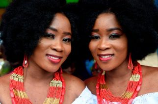 Identical twin sisters Kehinde Olofin (L) and Taye Olofin take part in the Igbo-Ora World Twins festival on Saturday... Photo credit: AFP