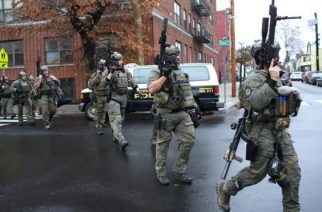 Police exchanged gunfire with two suspected gunmen for over an hour