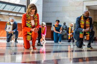 House Speaker Nancy Pelosi (D-Calif.) and other members of Congress observe a moment of silence at the Capitol's Emancipation Hall on Monday. (Manuel Balce Ceneta/AP)