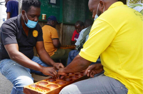 Warri is a board game popular in Antigua, and groups get together to play across the island