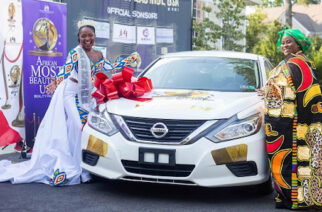 Christelle(left) receives her car from Nana Akosua Nkrumah Adasa III